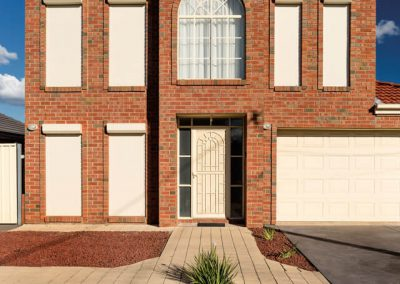 Roller shutters on red brick home